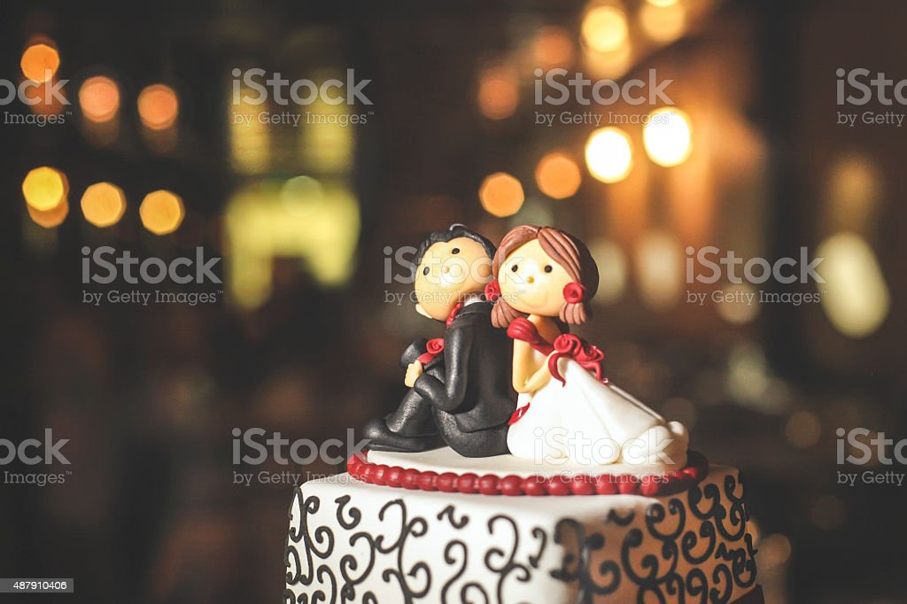 Cute wedding cake figurines stock photo