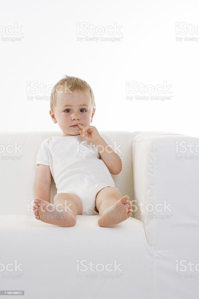 Cute white boy on sofa royalty-free stock photo