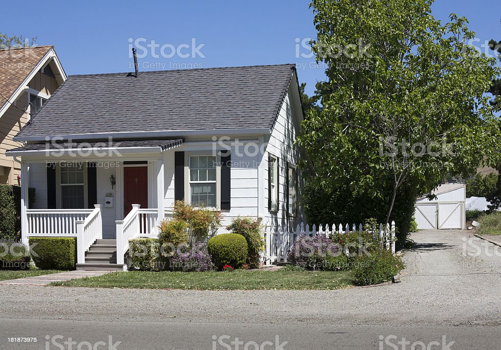 Cute white house with porch and picket fence royalty-free stock photo