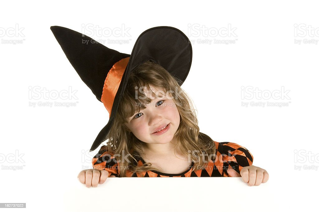 Cute witch behind blank sign royalty-free stock photo