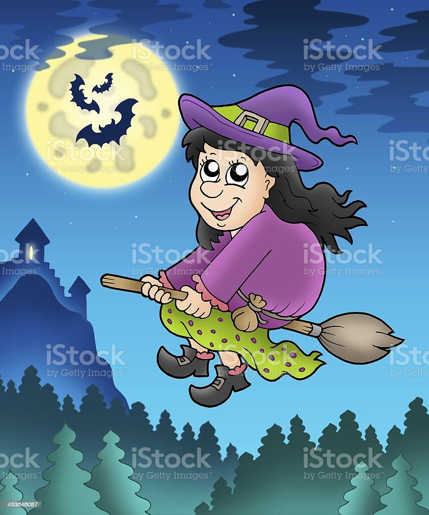 Cute witch on broom near castle stock photo