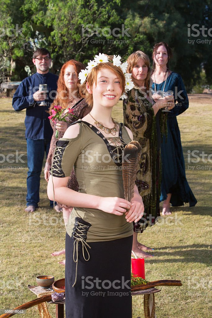 Cute Witch with Altar Outdoors stock photo
