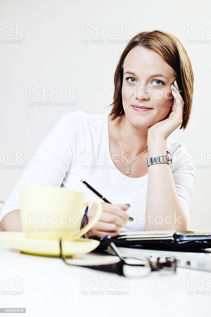 Cute woman at her desk royalty-free stock photo