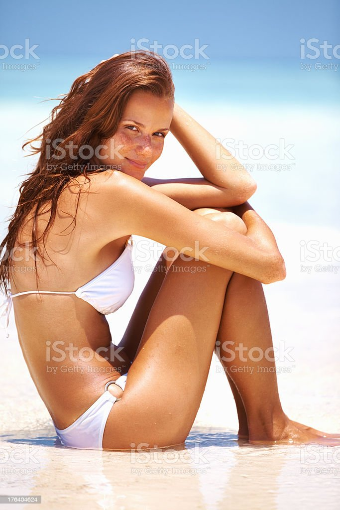 Cute woman at seashore stock photo