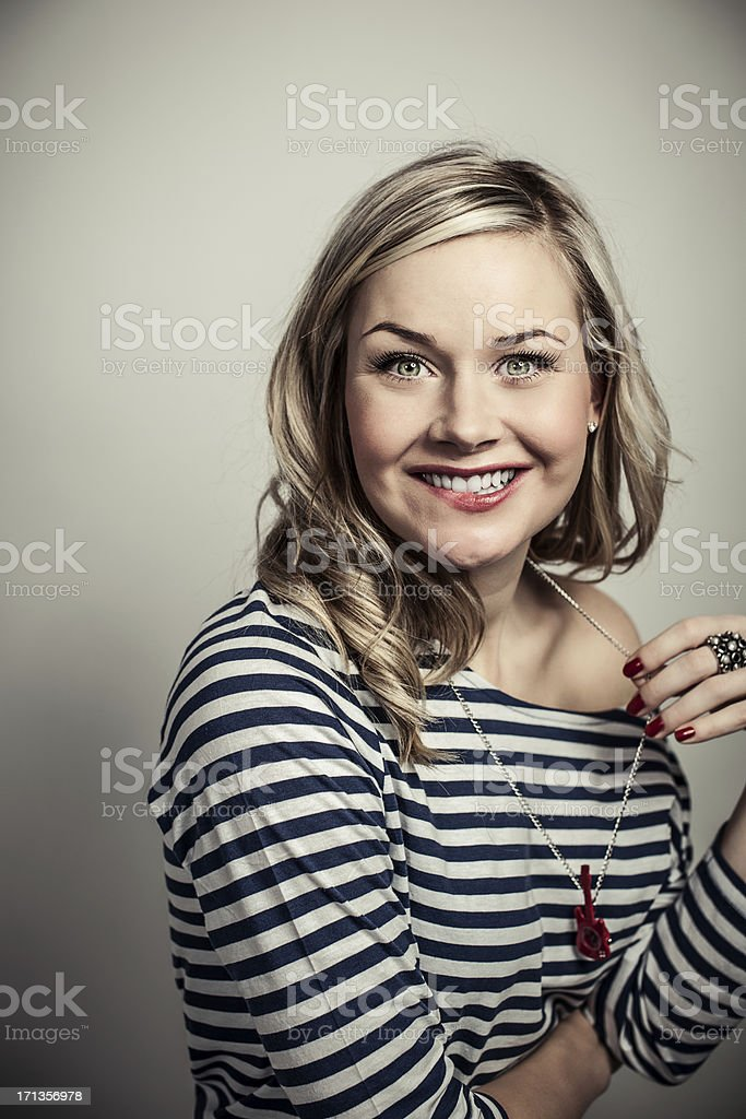 Cute woman biting lip stock photo