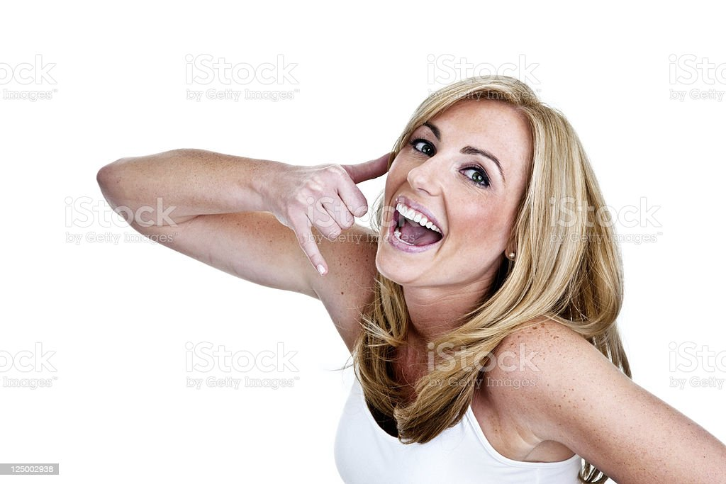Cute woman gesturing call me royalty-free stock photo