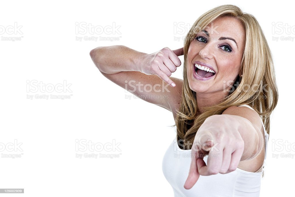 Cute woman gesturing call me pointing to viewer stock photo