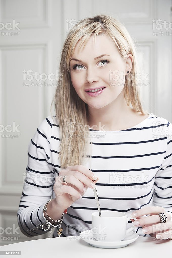 Cute woman in a striped shirt royalty-free stock photo
