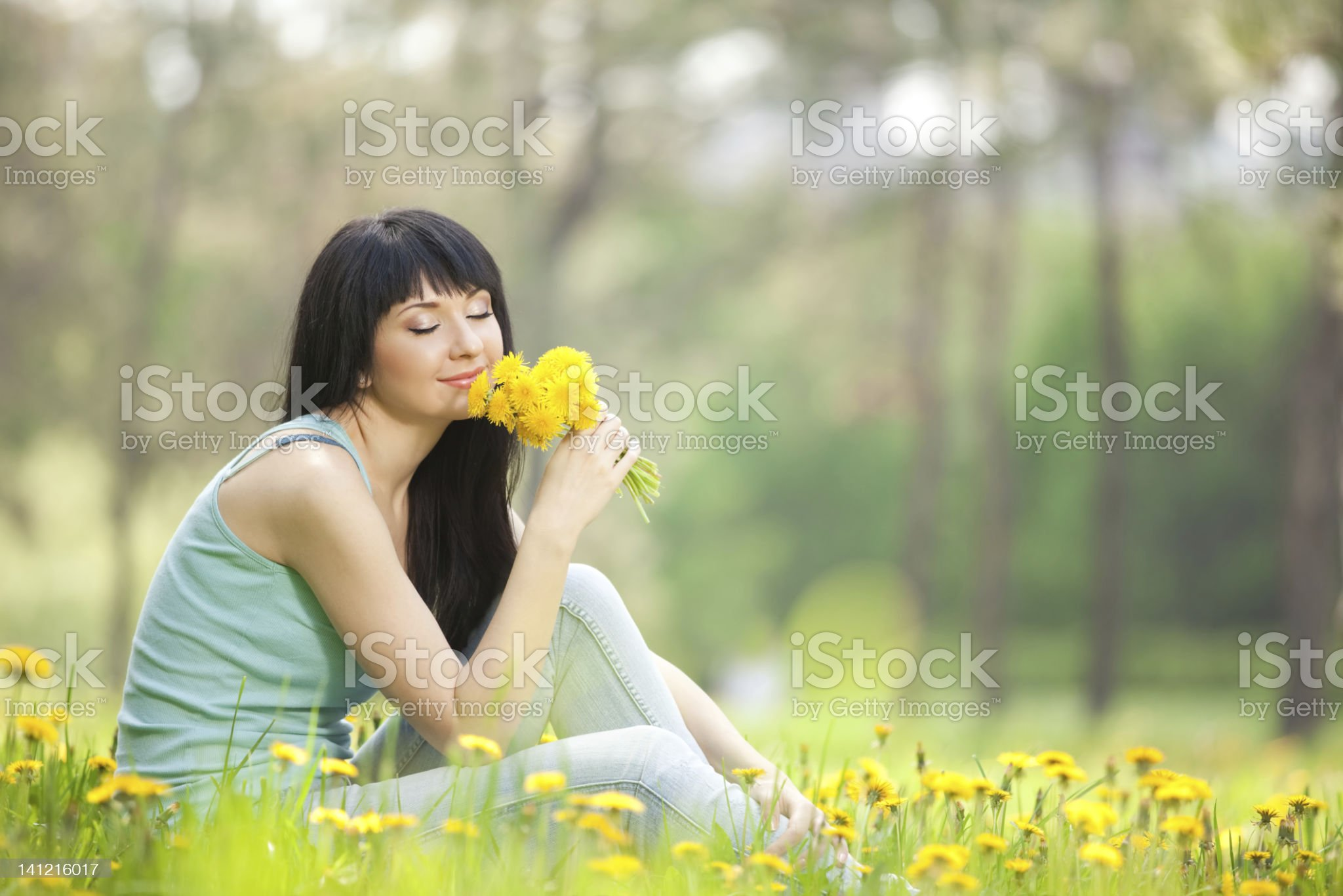 Cute woman in the park with dandelions royalty-free stock photo