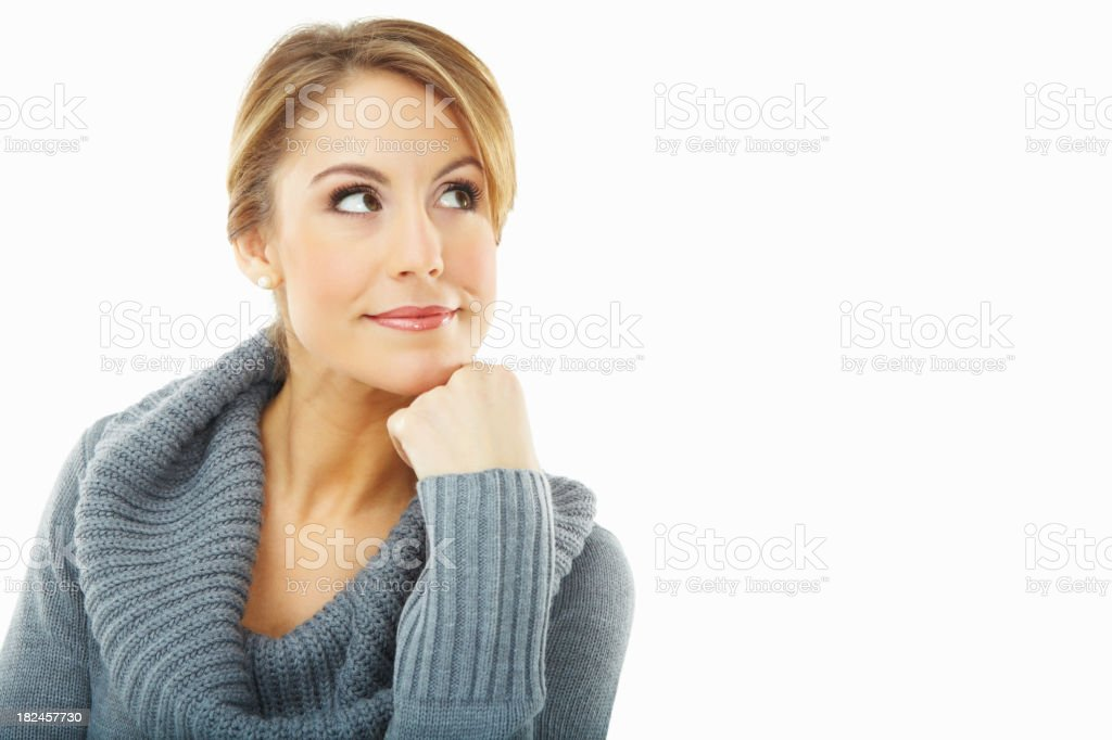Cute woman in winter wear looking at copyspace royalty-free stock photo
