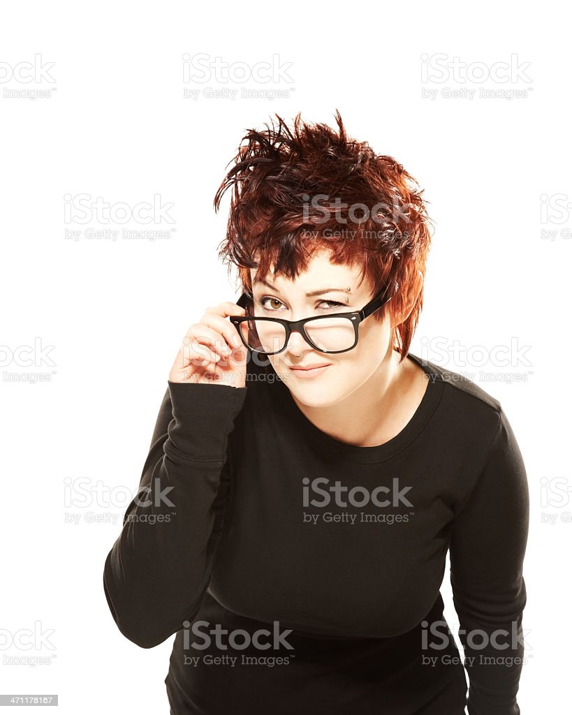 Cute woman looking curious through eyeglasses royalty-free stock photo