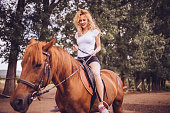 Cute woman on a horse