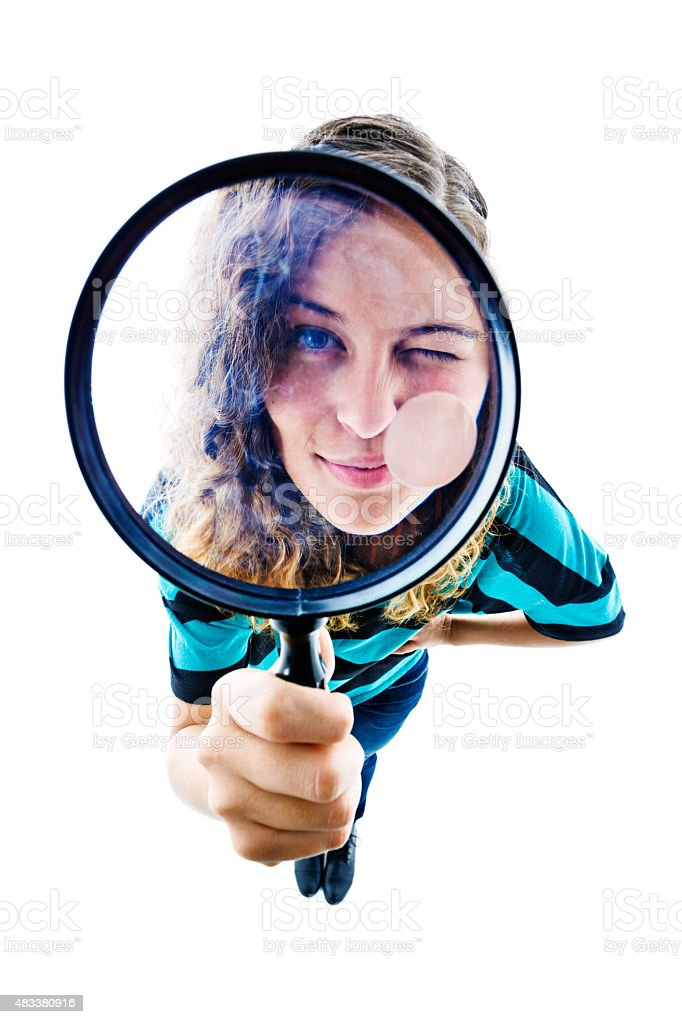 Cute woman peering up through magnifying glass, distorted by fisheye stock photo