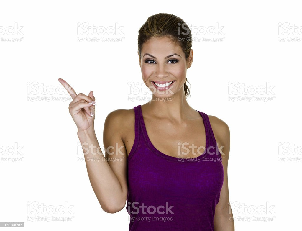 Cute woman pointing to copy space royalty-free stock photo