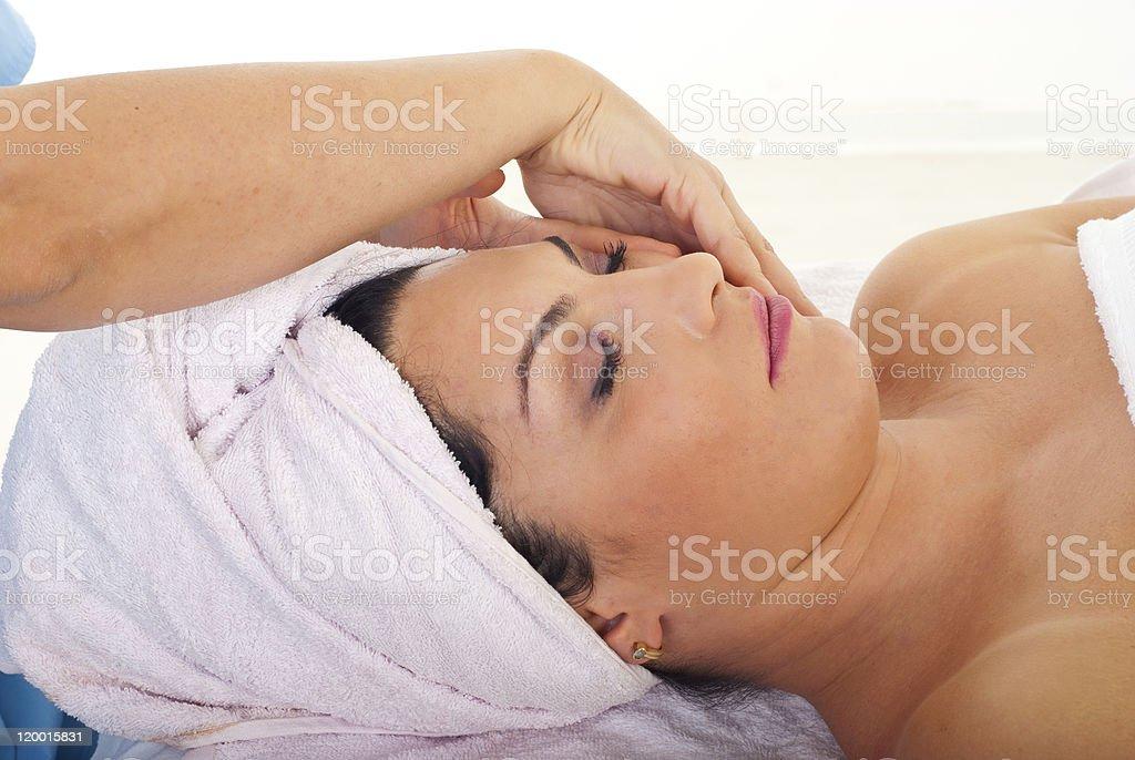 Cute woman receiving facial massage royalty-free stock photo