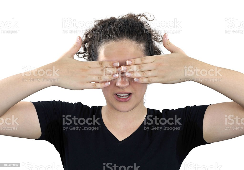 Cute woman shows emotion seeing nothing, isolated on white royalty-free stock photo