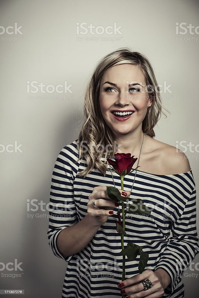 Cute woman with a red rose stock photo