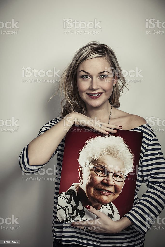Cute woman with her grandmothers portrait royalty-free stock photo