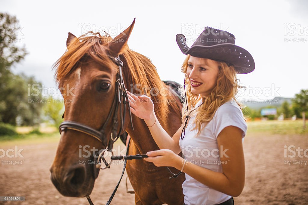 Cute woman with her horse stock photo
