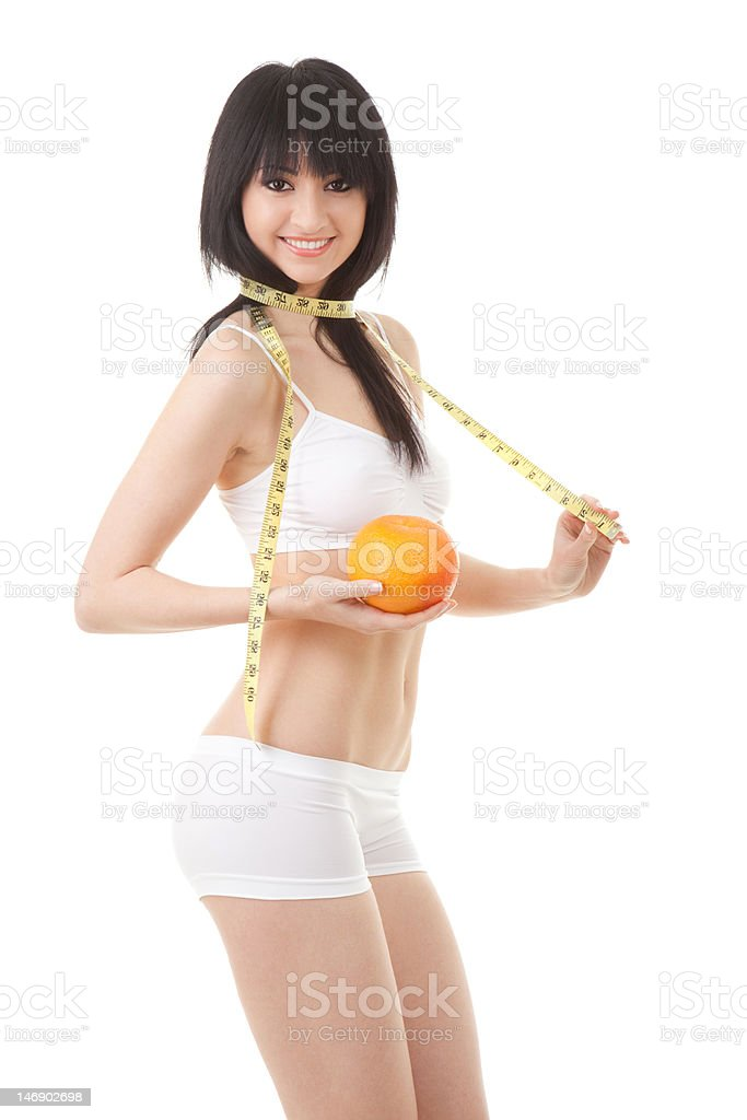 Cute woman with orange and measure tape royalty-free stock photo