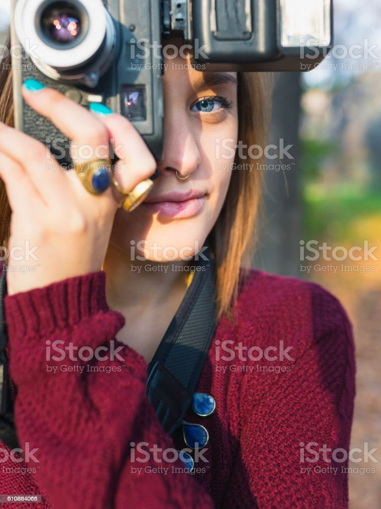 Cute woman with photo camera stock photo