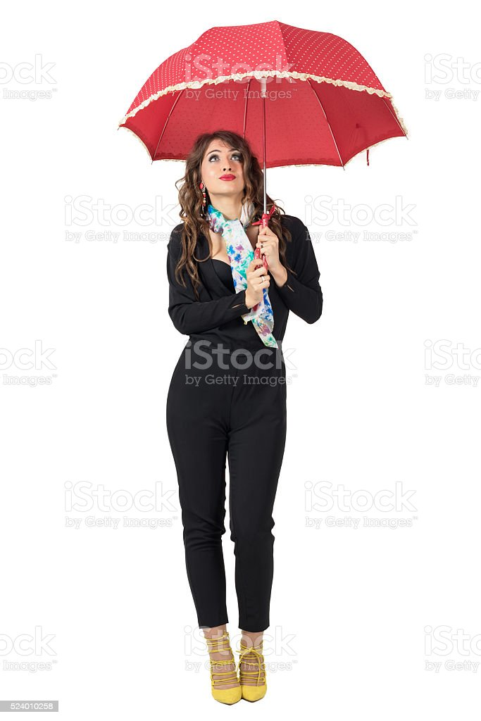 Cute woman with scarf under umbrella expecting rain looking up stock photo