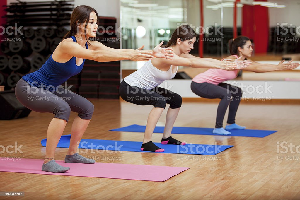 Cute women doing some squats stock photo