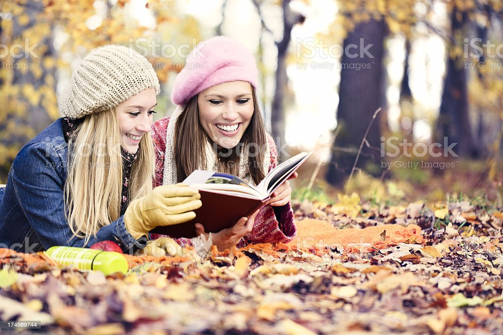 Cute women reading a book royalty-free stock photo