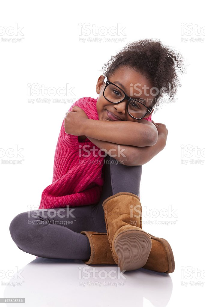 Cute young African American girl seated on the floor royalty-free stock photo
