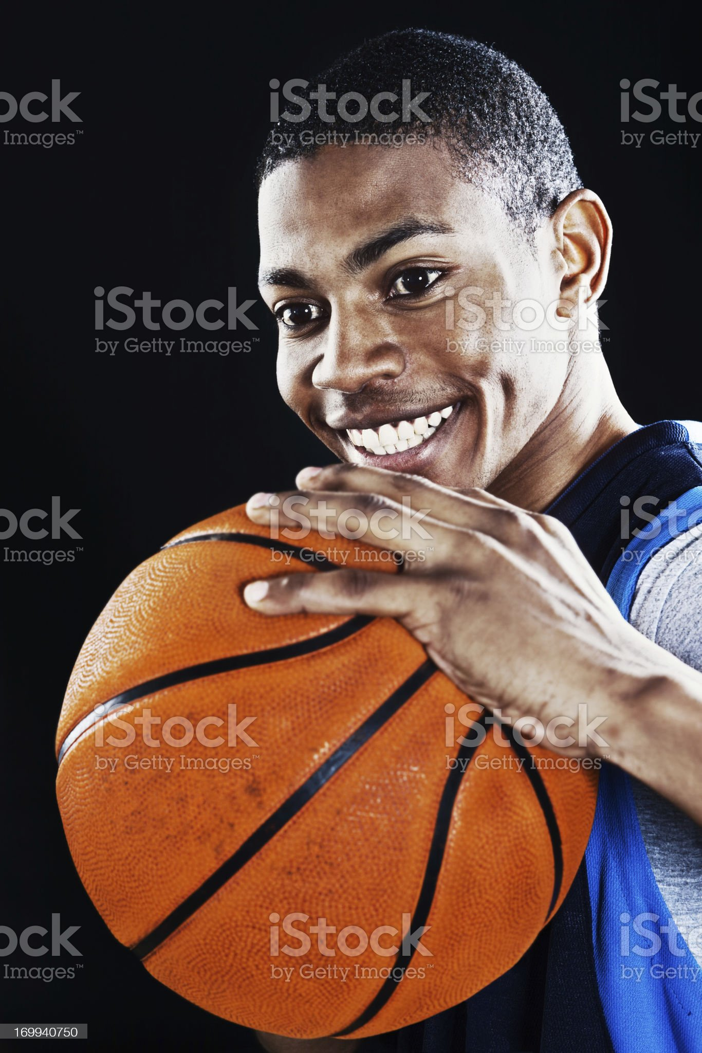 Cute young basketball player smiles, ready to play royalty-free stock photo