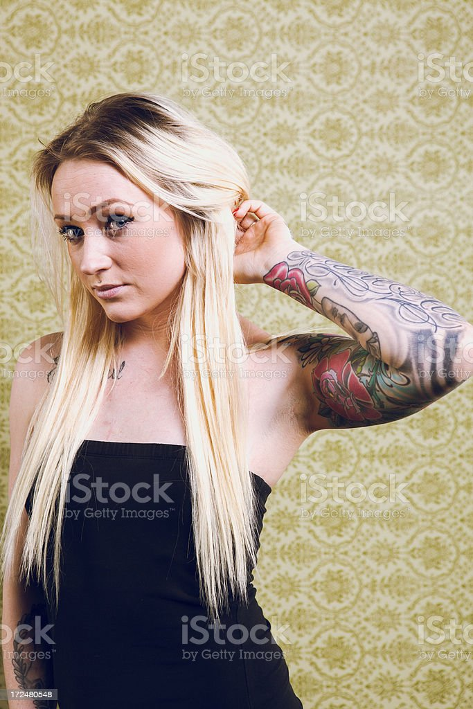 Cute Young Blond Tattooed Woman royalty-free stock photo