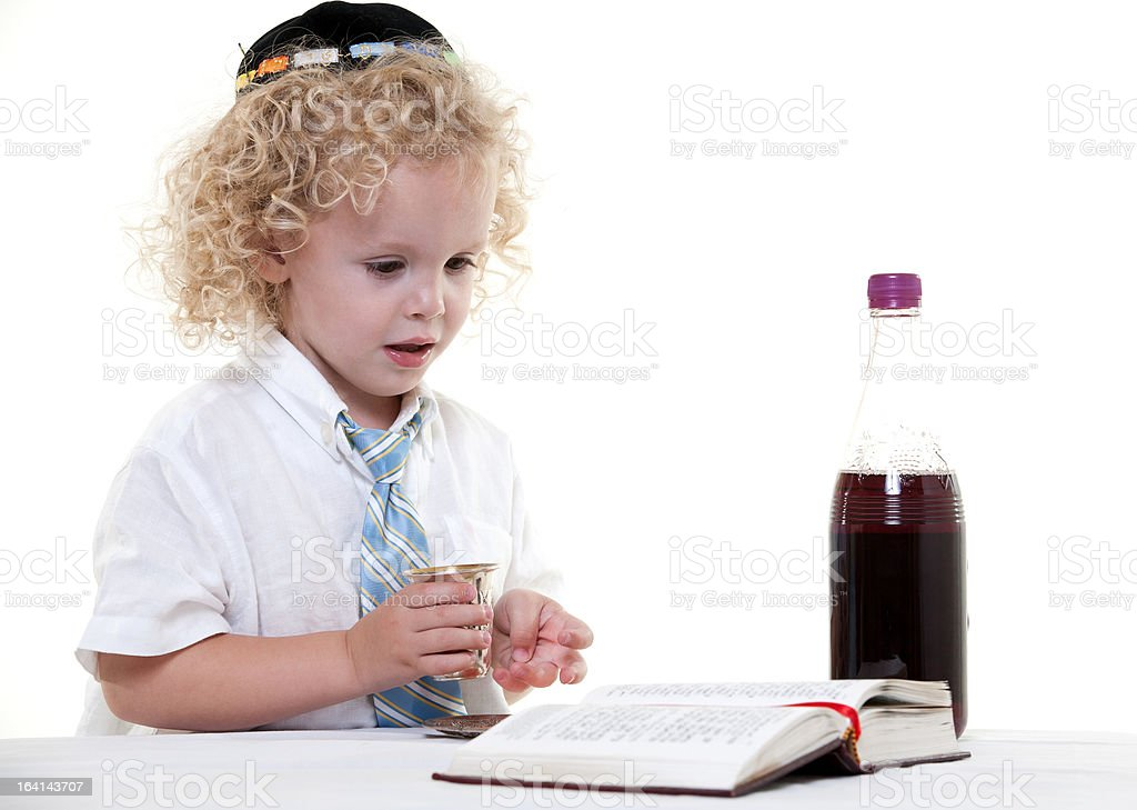 Cute young blond toddler jewish boy playing pretend royalty-free stock photo