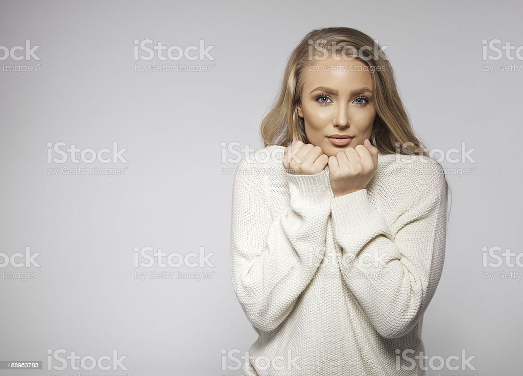 Cute young blonde posing on grey background stock photo