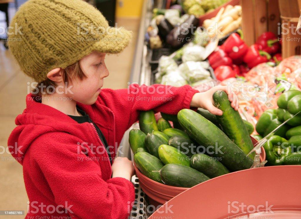 Cute Young Boy Choosing Organic Vegetables royalty-free stock photo