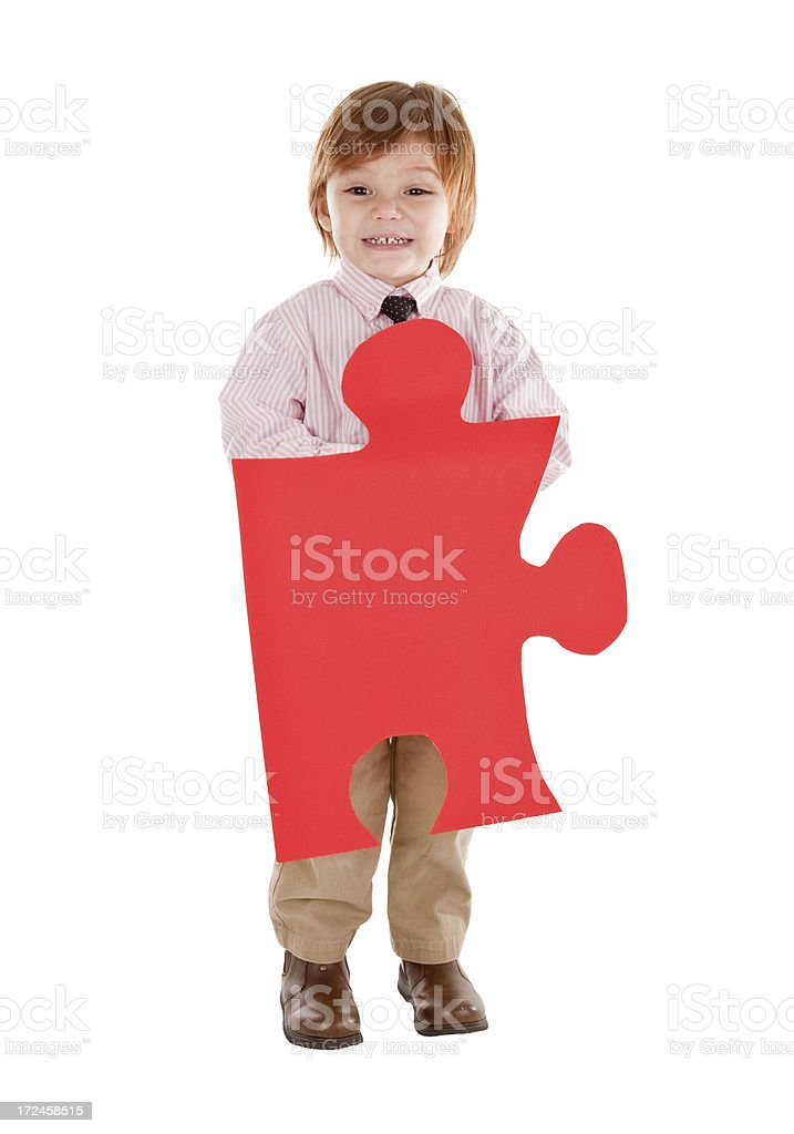 Cute Young Boy Holding Red Jigsaw Puzzle Piece royalty-free stock photo