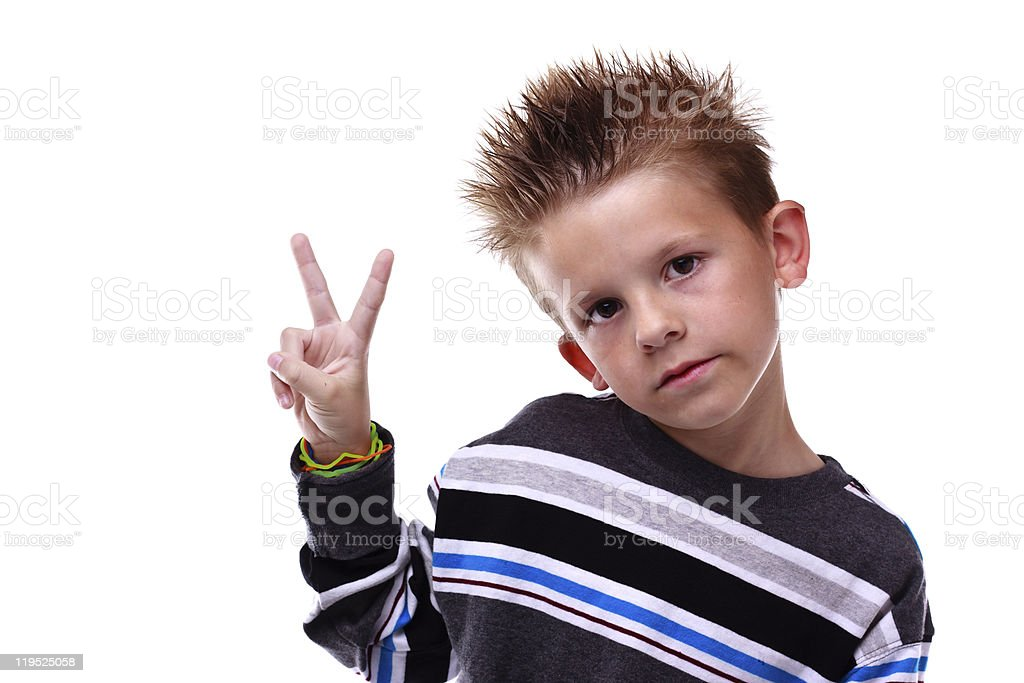 Cute young boy holding up the peace sign royalty-free stock photo