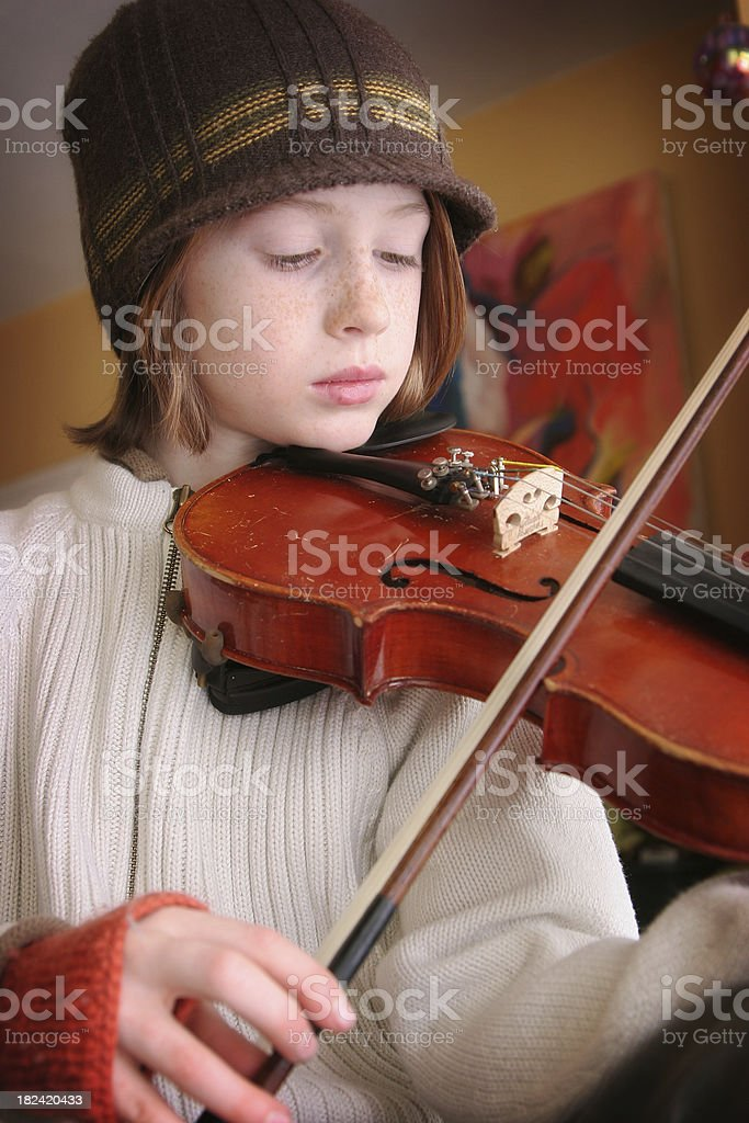 Cute young boy playing his violin stock photo