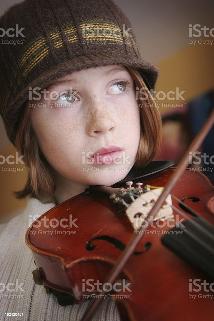Cute young boy playing his violin royalty-free stock photo
