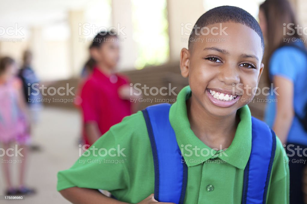 Cute young boy smiling at school campus royalty-free stock photo