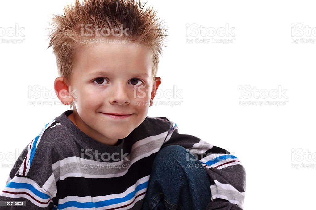 Cute young boy smiling at the viewer royalty-free stock photo