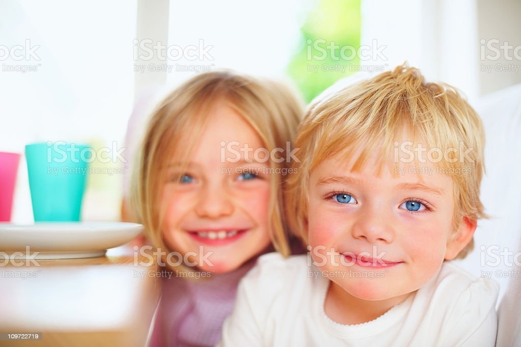 Cute young boy with his sweet sister royalty-free stock photo
