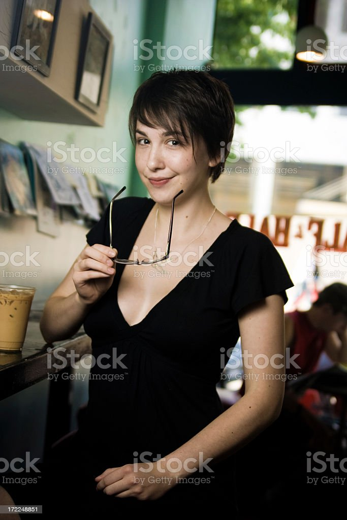 cute young brunette in urban coffee shop royalty-free stock photo