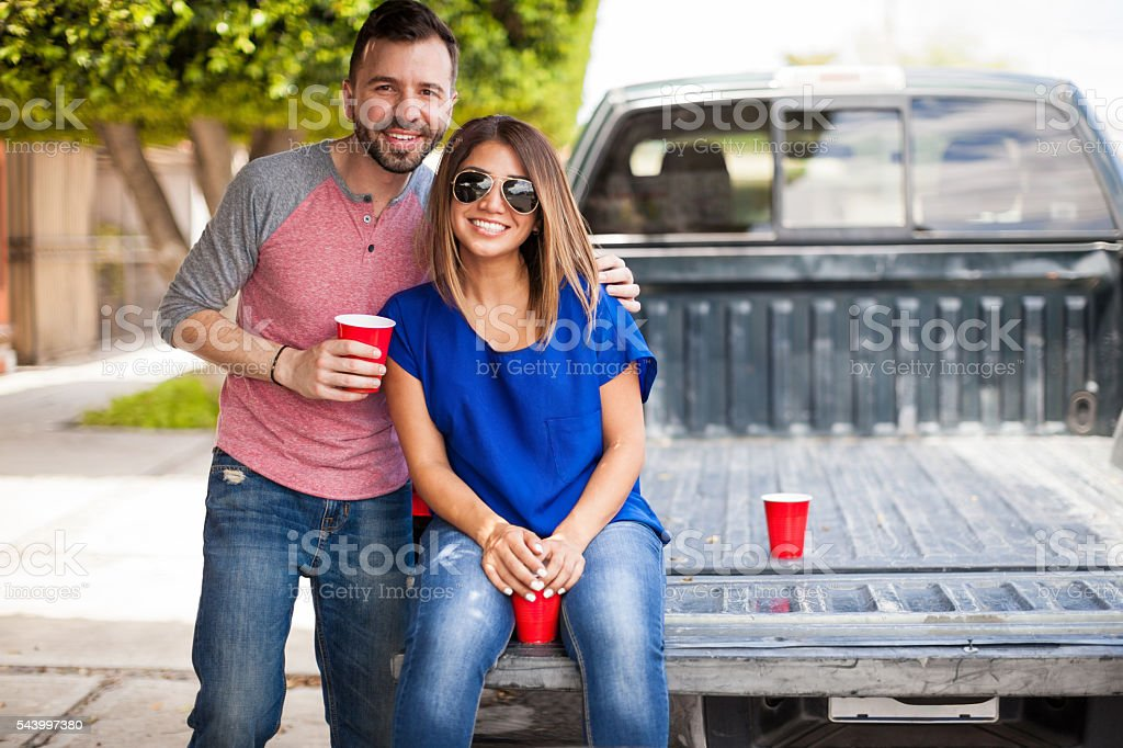 Cute young couple hanging out outdoors stock photo