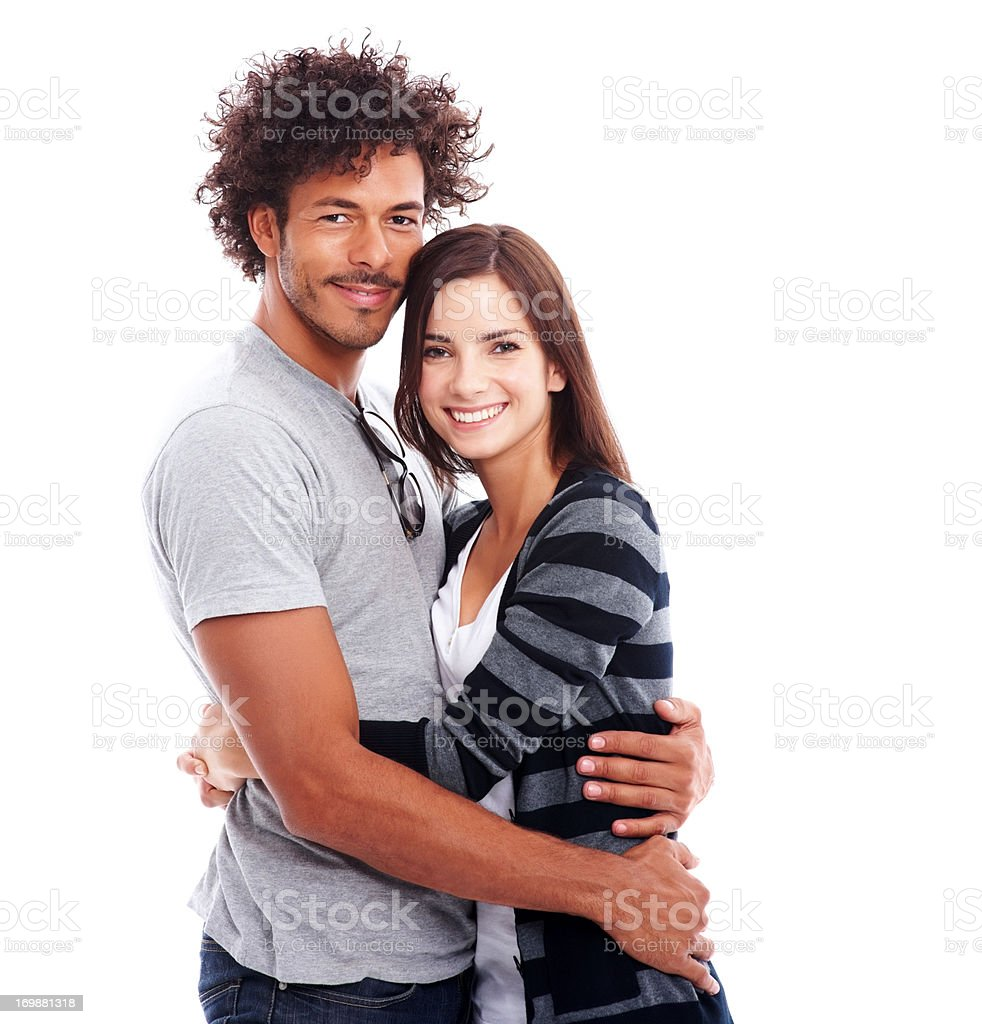 A cute young couple in love hugging over white background stock photo