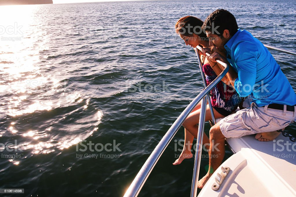 Cute Young Couple on Front of Ocean Boat stock photo