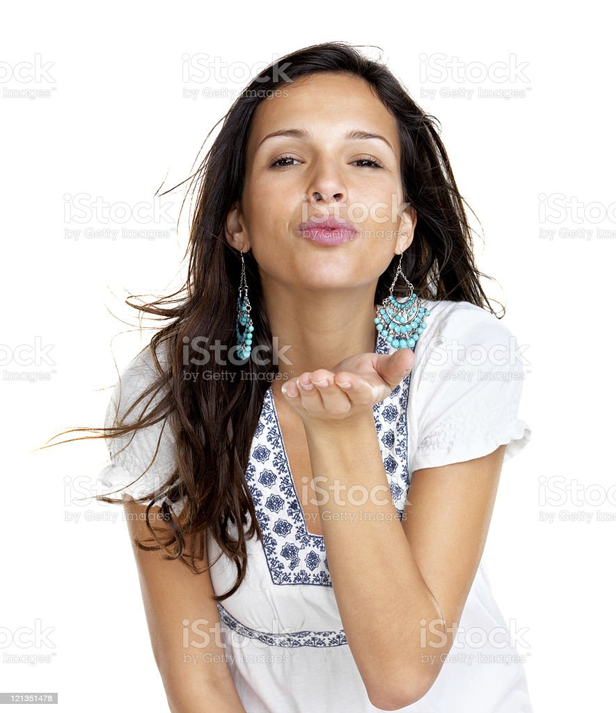 Cute, young female blowing kiss on white background royalty-free stock photo