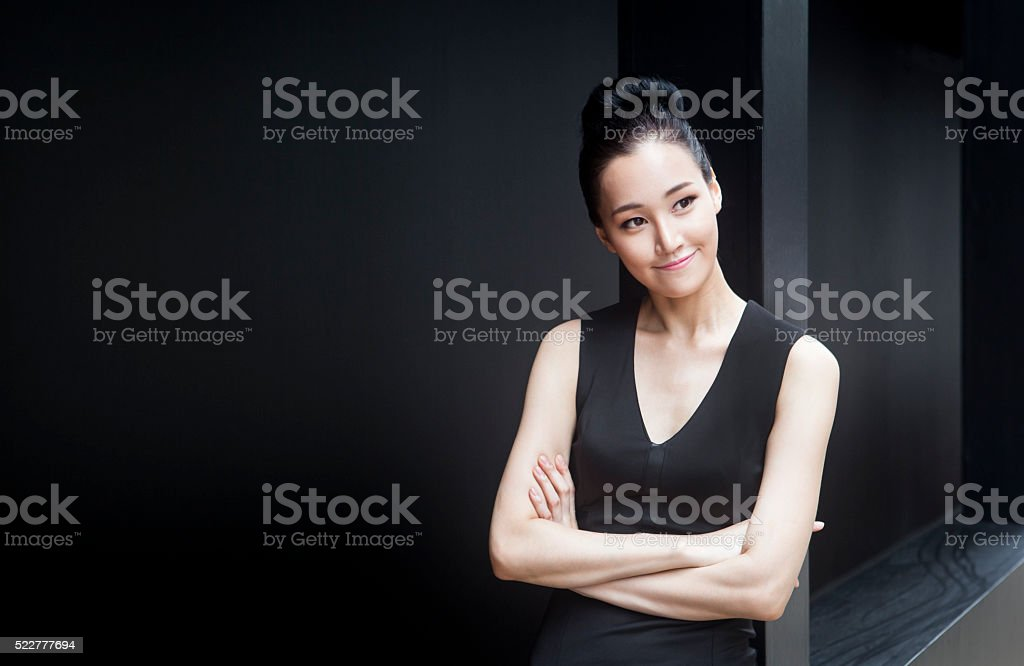 Cute Young Female Entrepreneur Thinking About Her Dreams stock photo