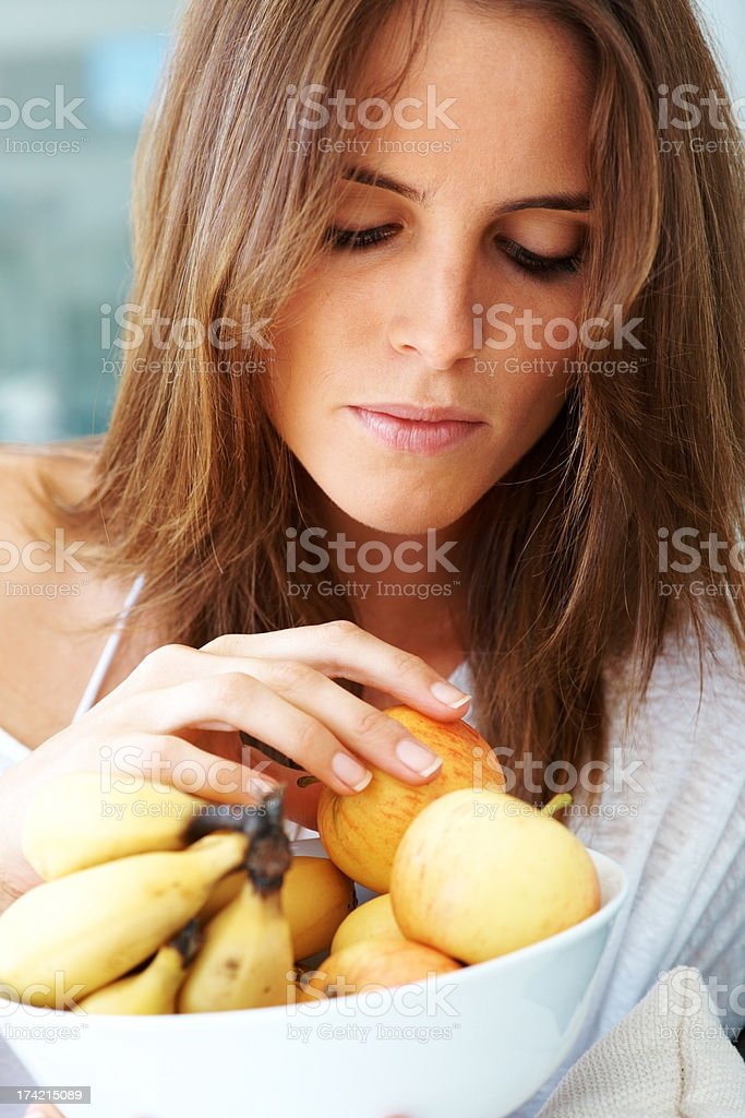 Cute young female holding a bowl of fruits stock photo