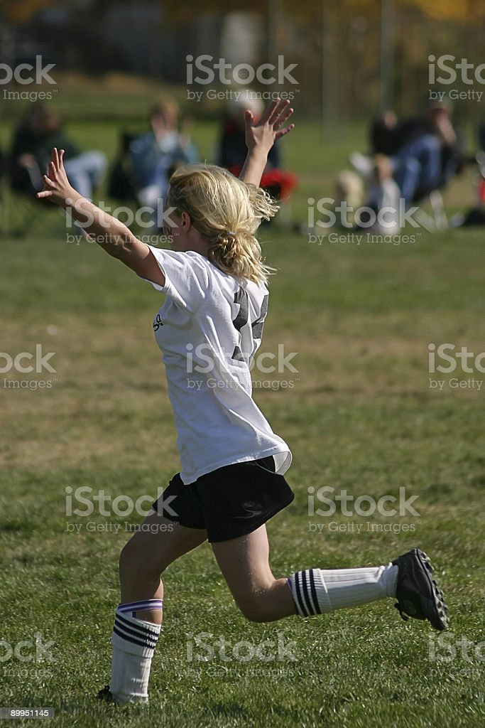 Cute Young Female Soccer Player Expresses Joy of Victory stock photo