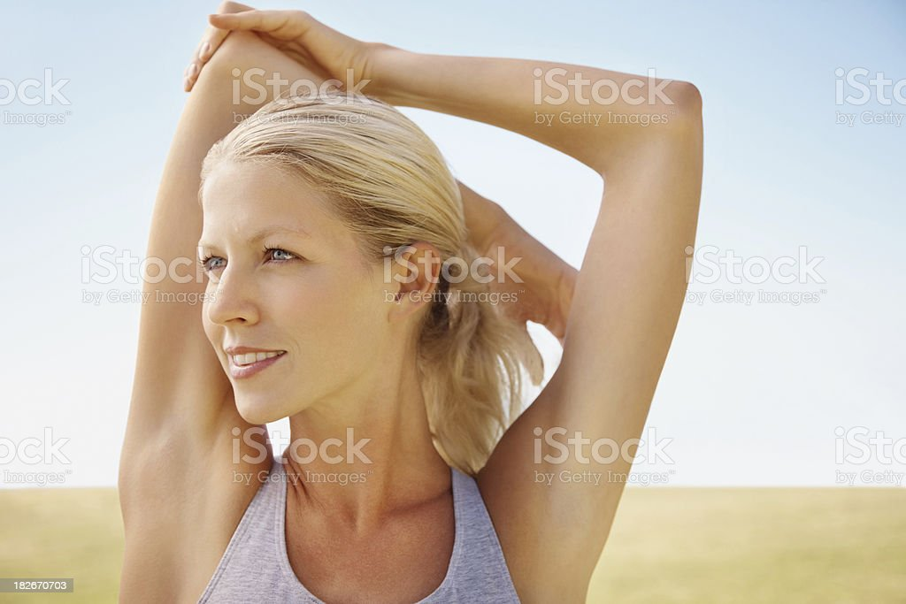 Cute young female stretching out outdoors royalty-free stock photo